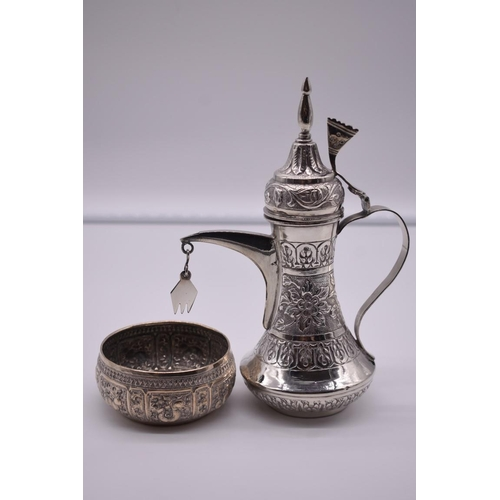 117 - <strong>An Arabic white metal dallah, </strong>20.5cm high; together with a similar small decorative...