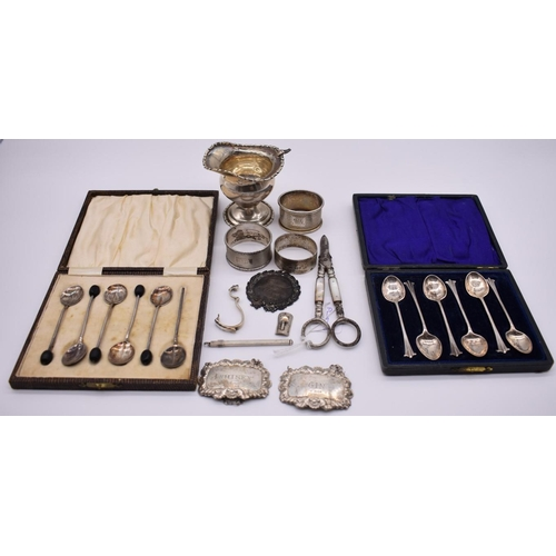 119 - <strong>Two cased sets of silver coffee spoons</strong>; together with three silver napkin rings; tw...