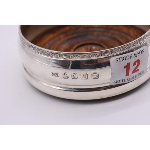 12 - <strong>An Irish silver bottle coaster</strong>, by<em> P W K</em>, Dublin 1999, 10cm diameter....