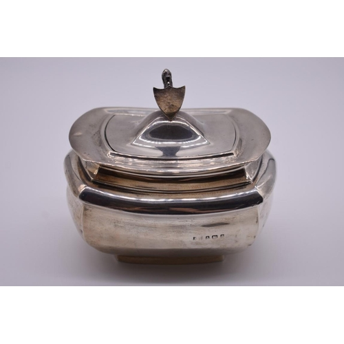 122 - <strong>An Edwardian silver tea caddy</strong>, having lion and shield finial, probably by<em>Jones...