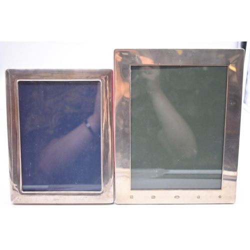 124 - <strong>A silver photograph frame,</strong> by<em>Kitney & Co,</em> London 2000, 25 x 20cm; tog...