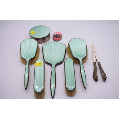 125 - <strong>A six piece silver and green enamel dressing table set,</strong> by <em>Wilson & Gill, <...