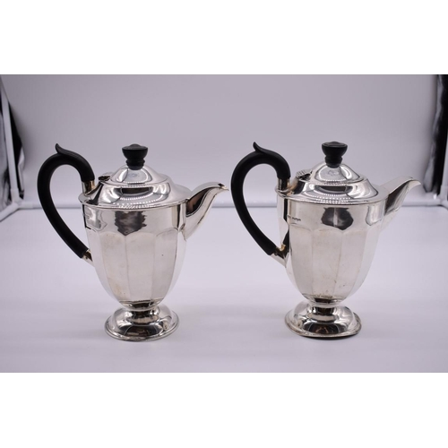 126 - <strong>A pair of silver hot water pots</strong> by <em>Viners</em>, Sheffield 1936, 20cm high, 821g...