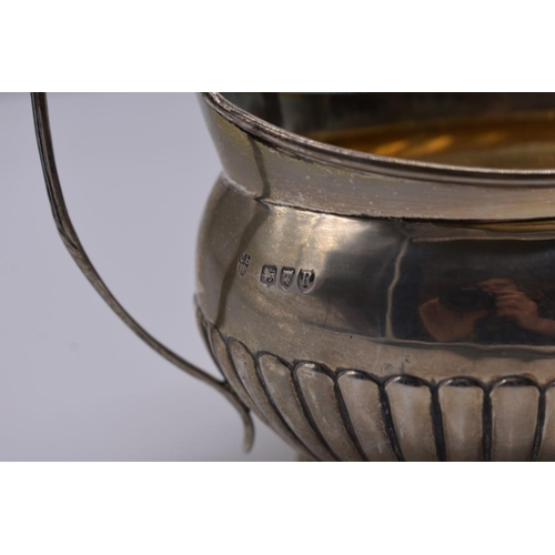 127 - <strong>A Victorian silver teapot and sugar bowl, </strong>by<em> Charles Stuart Harris, </em>London...