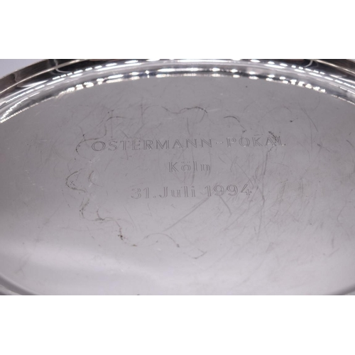 133 - <strong>A German sterling silver oval tray, </strong>by <em>E H,</em>31cm diameter; together with a...