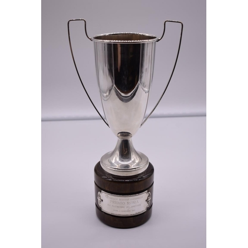 137 - <strong>A continental white metal twin handled trophy cup,</strong> stamped 800, on wood socle, 31cm...