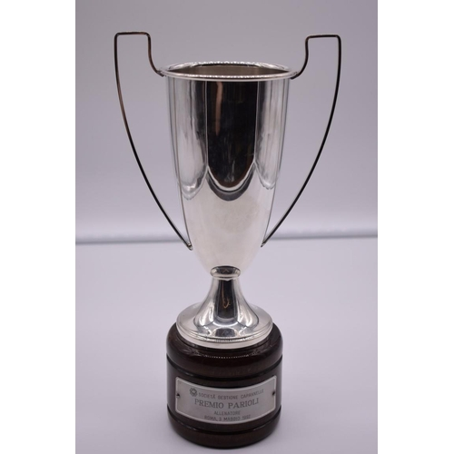 138 - <strong>A continental white metal twin handled trophy cup</strong>, stamped 800, on wood socle, 31cm...
