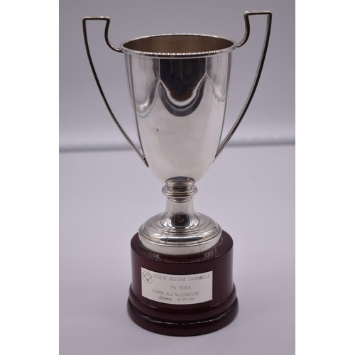 140 - <strong>An Italian white metal twin handled trophy cup,</strong> stamped 925, on wood socle, 23.5cm ...