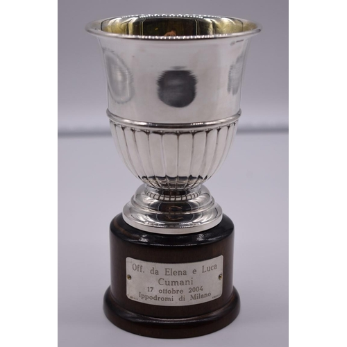 143 - <strong>An Italian white metal trophy cup,</strong> by <em>R Miracoli,</em> stamped 800, on wood soc...