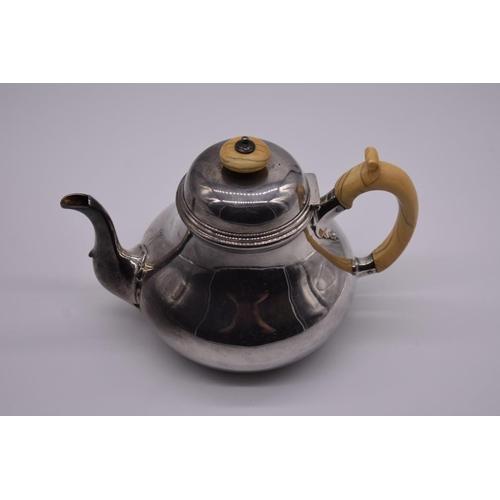 16 - <strong>A Victorian silver teapot,</strong> by<em> R & S Garrard & Co</em>, London 1850, hav...