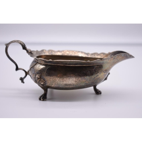 17 - <strong>A Continental white metal sauce boat</strong>, <em>marks indistinct, </em>5.5cm high....