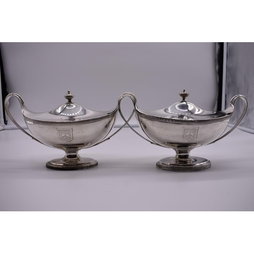 18 - <strong>A pair of George III silver oval pedestal sauce tureens and covers,</strong> by <em>Henry Ch...