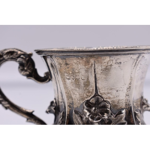 19 - <strong>A William IV rococo silver baluster mug,</strong> <em>makers mark indistinct, </em>London 18...