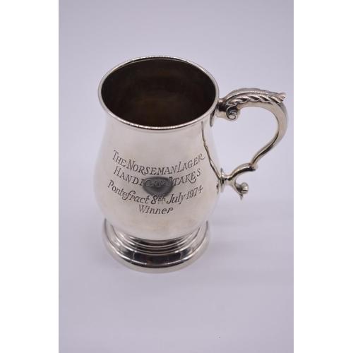 21 - <strong>A silver baluster mug,</strong> by <em>J W Flynn,</em> London 1973, engraved presentation, 1...