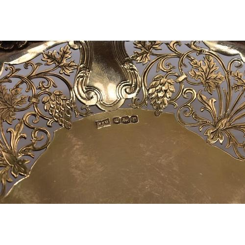 26 - <strong>A pair of pierced silver gilt bonbon dishes</strong>, by <em>Walker & Hall, </em>Sheffie...