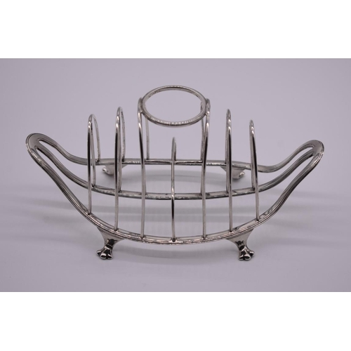 39 - <strong>An unusual Edwardian silver combination egg holder and toast rack</strong>, by <em>Thomas Br...