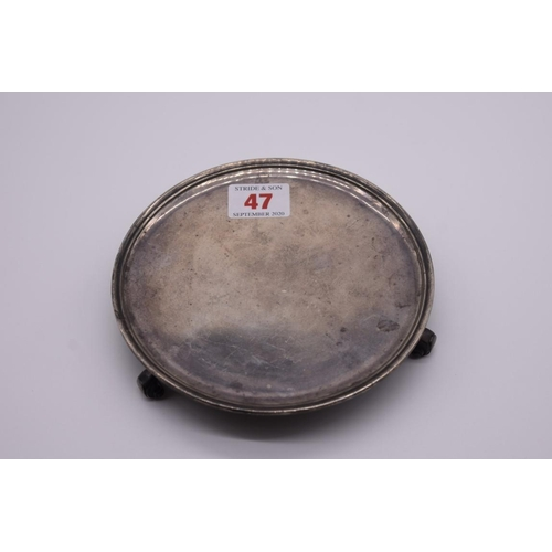 47 - <strong>A silver waiter,</strong> by <em>William Lister & Sons,</em> London 1932, 15cm diameter,...
