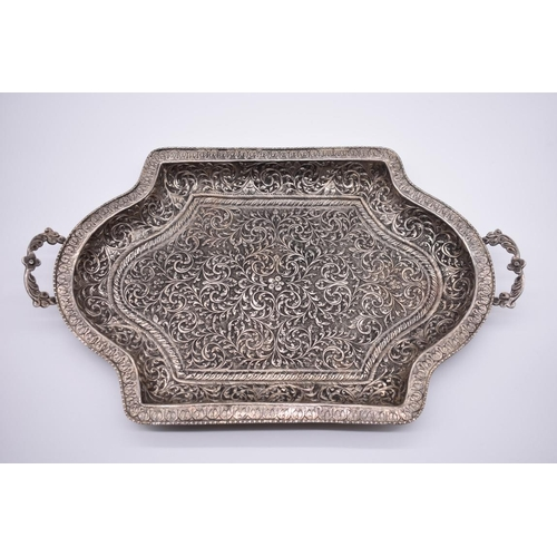 48 - <strong>An ornate Arabic twin handled rectangular tray</strong>, stamped silver, 46.5cm wide....