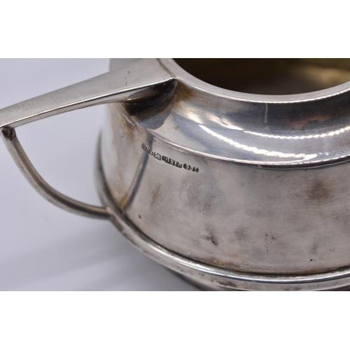 5 - <strong>An Art Deco Indian white metal three piece tea set,</strong>by <em>P</em> <em>Orr & Son...
