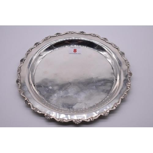 8 - <strong>A Continental .900 silver salver, </strong>24cm diameter....