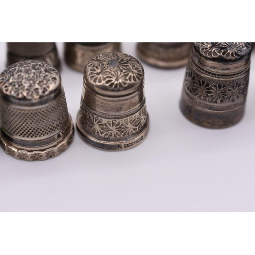 99 - <strong>An interesting collection of silver thimbles, </strong>114g; together with six others. (28)...