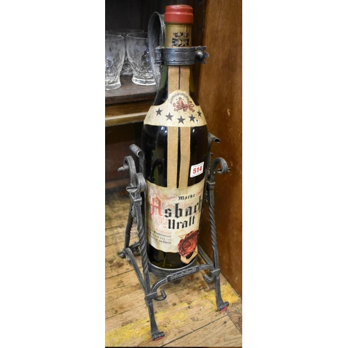 514 - <strong>A large old bottle of Asbach Uralt brandy,</strong> in pewter cradle, the bottle 50.5cm high...