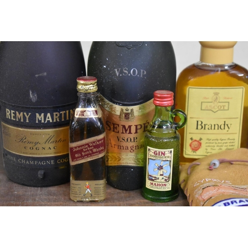 597 - <strong>A 68cl bottle of Remy Martin VSOP cognac;</strong> together with a 70cl bottle of Sempe arma...
