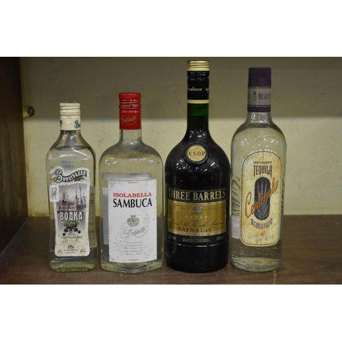 610 - <strong>Four bottles of spirits,</strong> to include: a 1 litre bottle of Three Barrels VSOP brandy....