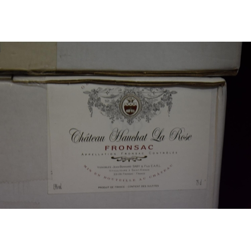 624 - <strong>A case of twelve 75cl bottles of Chateau Hauchat La Rose, 2005,</strong>Fronsac, in oc...