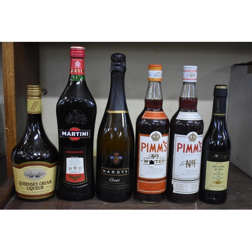 635 - <strong>A mixed lot of alcohol,</strong> to include: sherry, spirits; and liqueurs. (11)...