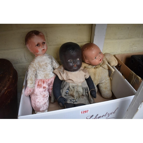 1297 - <strong>Three vintage baby dolls,</strong>to include a soft bodied black example, stamped to head, ...
