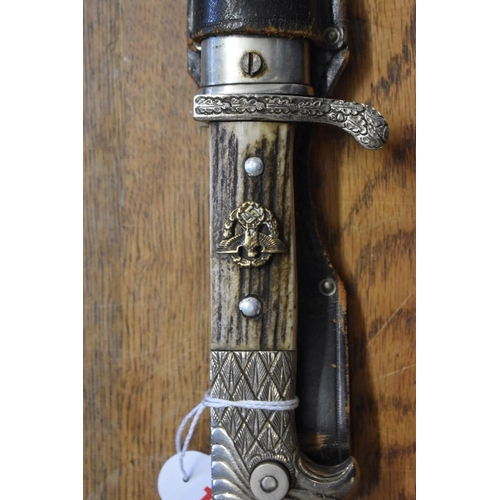 1775 - <strong>A World War II German Police bayonet and nickel plate mounted black leather sheath,</strong>...