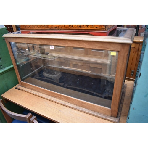 1005 - An early 20th century mahogany museum display case, with glazed top, 56cm high x 145cm wide x 49.5cm...