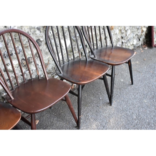 1034 - A set of six dark Ercol stick back dining chairs.<strong>This lot can only be collected on Saturday...
