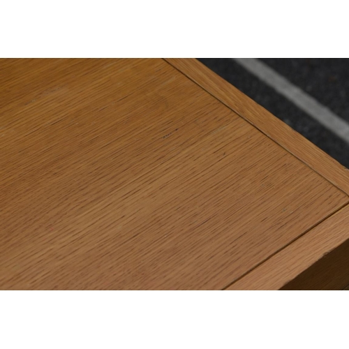 1000 - A modern oak dining table, 181cm long x 86cm wide. <strong>This lot can only be collected on Saturda...