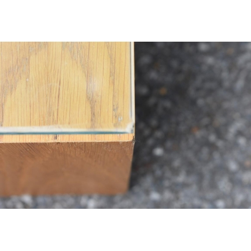 1001 - A modern coffee table, with glass top on wooden base, 130 x 76 x 27.5cm high. <strong>This lot can o...