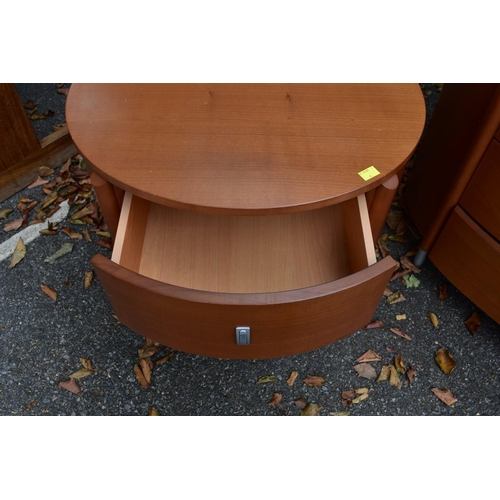 1003 - A contemporary cherrywood chest of four long drawers, 131 x 55.5cm; together with a pair of matching...