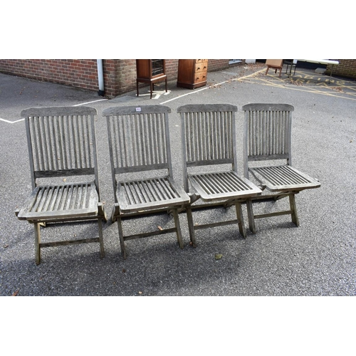 1013 - A set of four teak garden chairs. <strong>This lot can only be collected on Saturday 10th October. (...