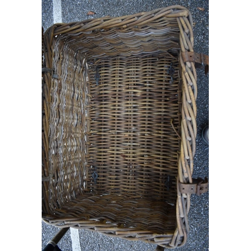 1014 - A wicker laundry basket, 80cm wide; together with a bamboo table, inset felt leaf to top, 72cm high....