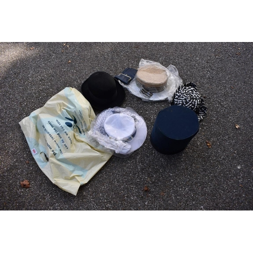 1020 - A small collection of hats and a purse. <strong>This lot can only be collected on Saturday 10th Octo...
