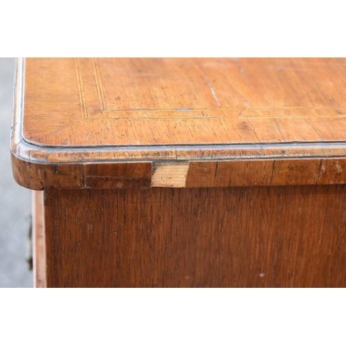 1029 - An 18th century walnut and inlaid chest of drawers, 108cm wide.<strong>This lot can only be collect...
