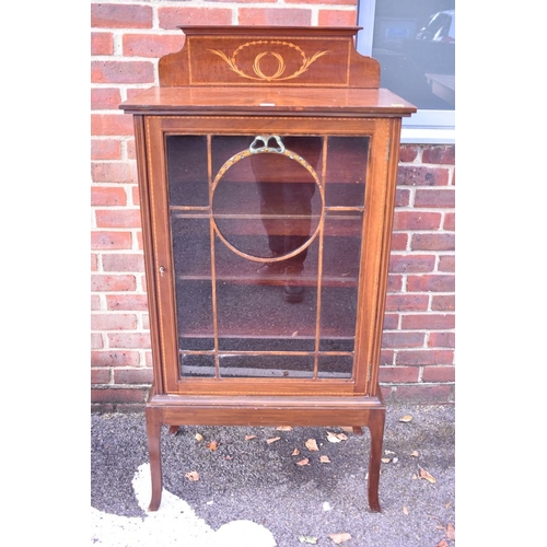 1033 - An Edwardian pier cabinet, having raised inlaid top, 66.5cm wide.<strong>This lot can only be colle...