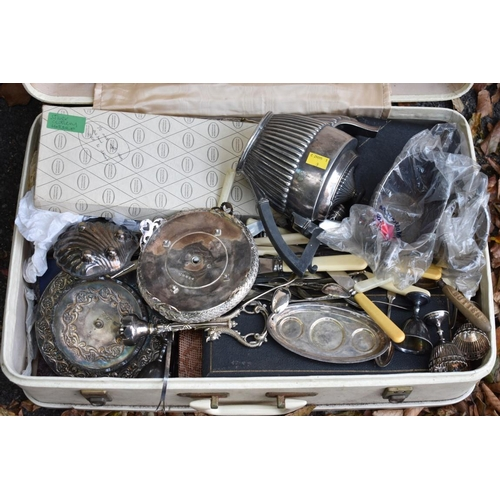 1038 - A quantity of silver plate and cutlery, in suitcase. <strong>This lot can only be collected on Satur...