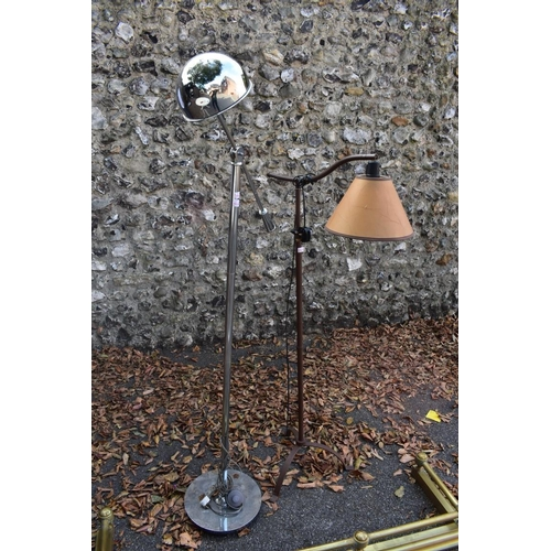 1066 - A brass fender, 135cm wide; together with two standard lamps.This lot can only be collected on Satu...
