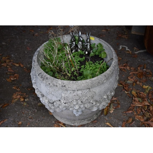 1073 - A reconstituted stone garden urn.<br /><strong>This lot can only be collected on Saturday 10th Octob...