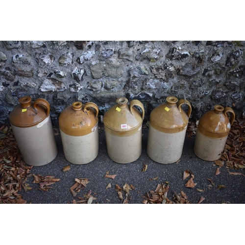 1083 - Five stoneware bottles.<br /><strong>This lot can only be collected on Saturday 10th October (10-2pm...