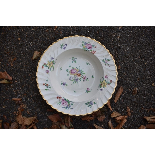 1084 - A collection of items comprising; a pair of Staffordshire dogs; a Clarice Cliff floral plate; four H...