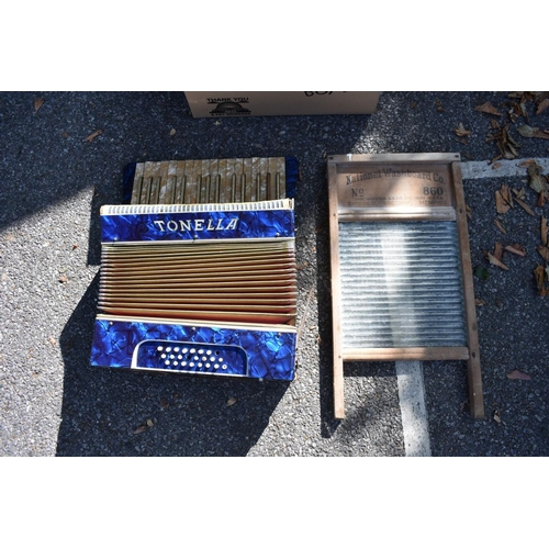 1087 - A Tonella accordion; together with an old washboard.<br /><strong>This lot can only be collected on ...