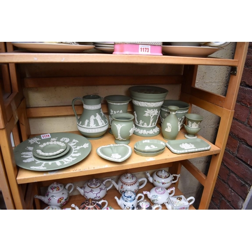 1174 - A collection of Wedgwood green jasperware.