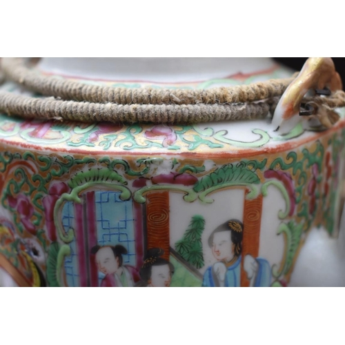 1176 - A mixed lot of pottery and porcelain, to include: a Chinese famille rose wine pot and associated cov...